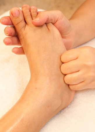 reflexology foot massage, spa foot treatment,Thailand Stock Photo - 10416663