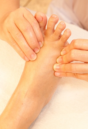 reflexology foot massage, spa foot treatment,Thailand Stock Photo - 10416662