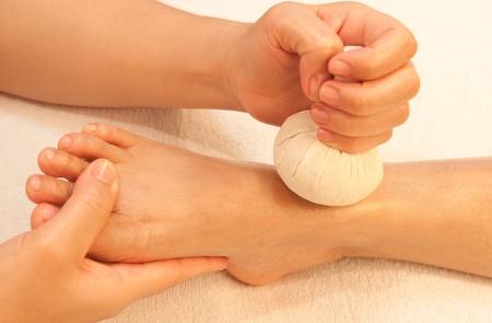 reflexology foot massage, spa foot treatment by ball herb,Thailand Stock Photo - 10416657