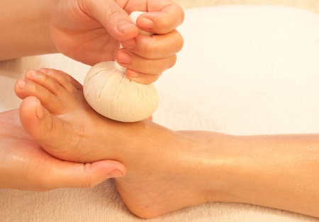 reflexology foot massage, spa foot treatment by ball herb,Thailand Stock Photo - 10416654