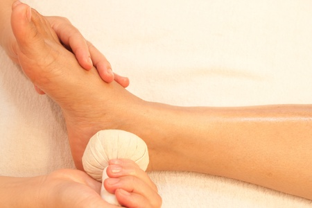 reflexology foot massage, spa foot treatment by ball herb,Thailand Stock Photo - 10416666