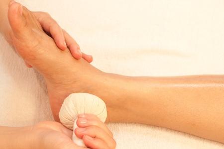 reflexology foot massage, spa foot treatment by ball herb,Thailand Stock Photo - 10416666