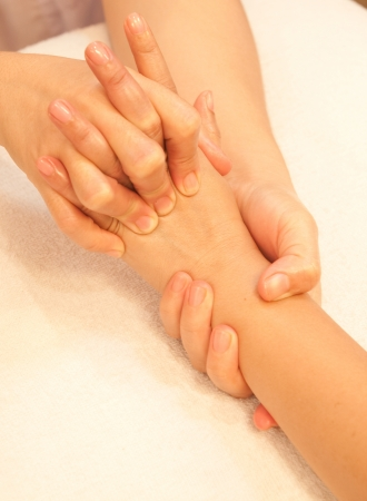 reflexology Hand massage, spa hand treatment,Thailand photo