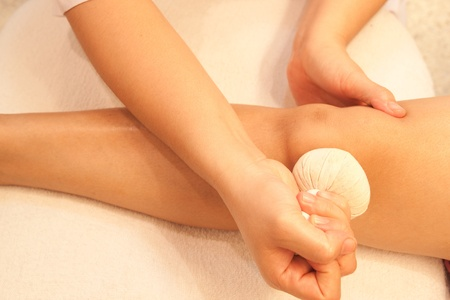 reflexology knee massage by ball herbal, spa knee treatment,Thailand. Stock Photo - 10459473