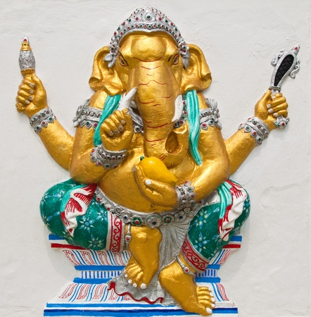 low relief: Indian or Hindu ganesha God Named Triaksara Ganapati at temple in thailand ;The conviction will be used hand to apply to the Lord for get the wishes. Stock Photo