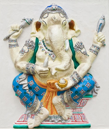 low relief: Indian or Hindu ganesha God Named Haridra Porasada Ganapati at temple in thailand ;The conviction will be used hand to apply to the Lord for get the wishes.