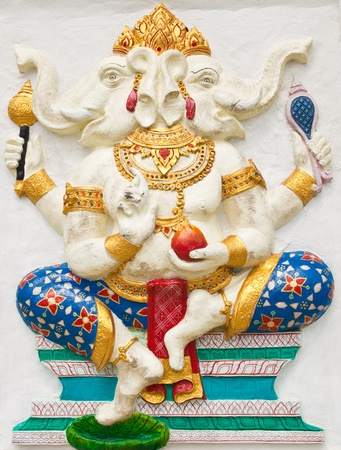 Indian or Hindu ganesha God Named Dwimukha Ganapati at temple in thailand ;The conviction will be used hand to apply to the Lord for get the wishes. Stock Photo - 10482672