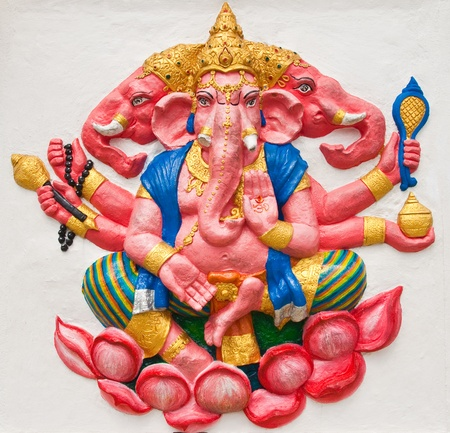 Indian or Hindu ganesha God Named Trimukha Ganapati at temple in thailand ;The conviction will be used hand to apply to the Lord for get the wishes. photo
