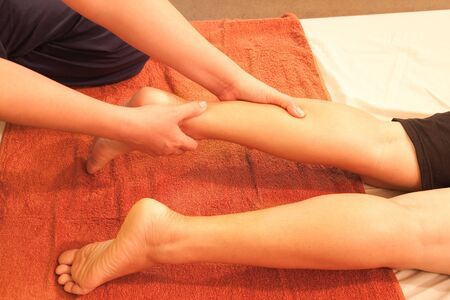 traditional healer: reflexology leg massage,Thai traditional massage,Thailand. Stock Photo