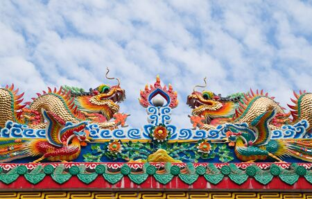 Chinese dragon and the blue sky in shrine,East of Thailand Stock Photo - 11239912