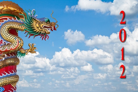 Dragon statue and year number with blue sky background photo