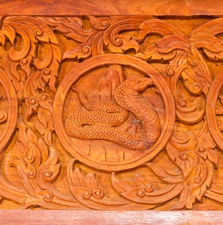 generality: Traditional Thai style wood carving as snake one of 12 Zodiac,Generality in Thailand, any kind of art decorated in Buddhist church etc. created with money donated by people, no restrict in copy or use