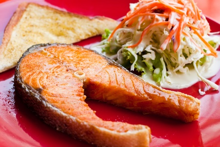 salmon steak with salad and bread photo