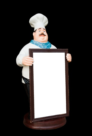 black appliances: Doll ceramic chef with whiteboard isolate on black background. Stock Photo