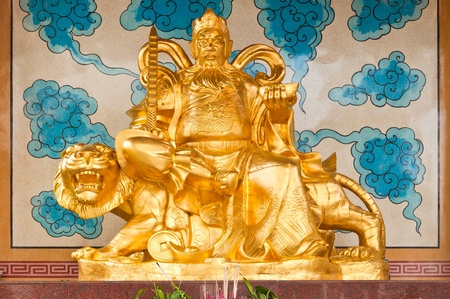 Golden Chinese Prosperity Money God sit on a tiger photo