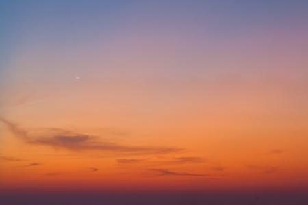 moon over the sea before  sunrise photo