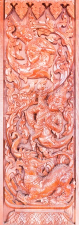 generality: Traditional Thai style wood carving on the door of church,Generality in Thailand, any kind of art decorated in Buddhist church. created with money donated by people, no restrict in copy or use