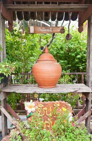 Jar clay of water for drink in Thai temple photo