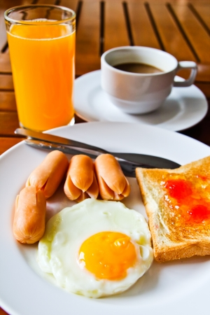 breakfast with fried eggs,sausage, toasts, juice and coffee Stock Photo - 15491199