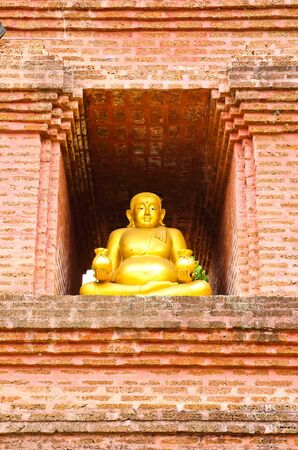 thep: Golden Buddha Sangkhajan. Sangkhajan. Thep god of fortune wealth money Buddha statue in the temple.