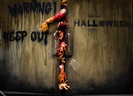 zombie hand through the door, useful for some Halloween concept  Stock Photo