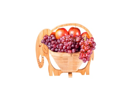 Red Grapes and Apples in wooden basket as elephants isolated on white background Stock Photo - 16403574