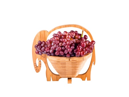 Red Grapes in wooden basket as elephants isolated on white background Stock Photo - 16403569