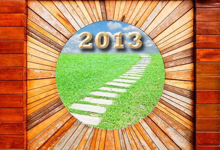 new year 2013 concept in Vintage wood pattern texture with walkway and blue sky background  photo