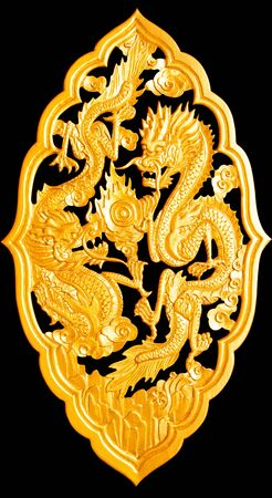 Golden wood dragon carving isolated on black background,with clipping path photo