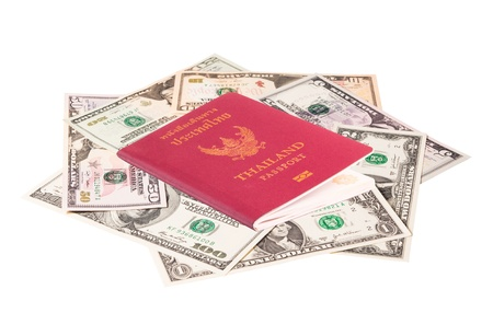 us dollar banknote with Thailand passport on white background photo