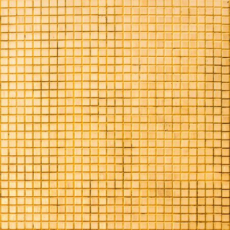 Grunge golden mosaic tiles texture  photo