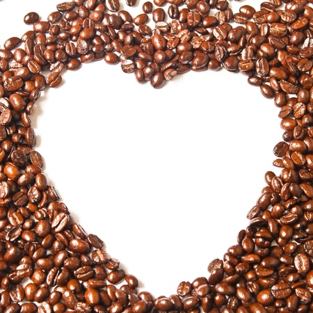 Heart from brown coffee beans and word of love photo