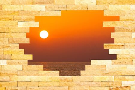 Crashed Brick Wall with beautiful sun set over the sea behind  Stock Photo - 17802305