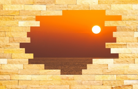 Crashed Brick Wall with beautiful sun set over the sea behind  Stock Photo - 17802315