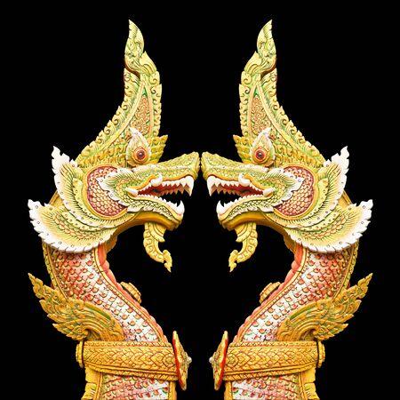 Twin Naga statue isolate on black background photo