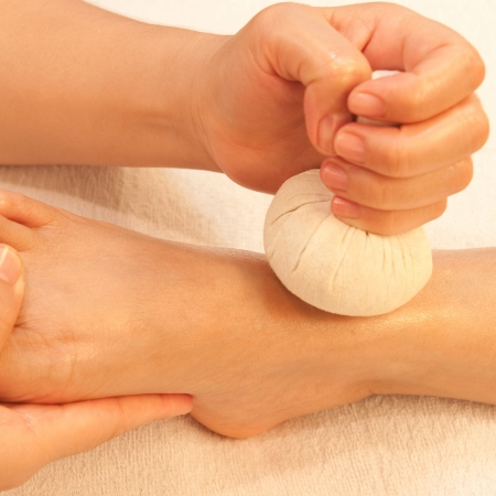 reflexology foot massage, spa foot treatment by ball herb,Thailand Stock Photo - 17949104