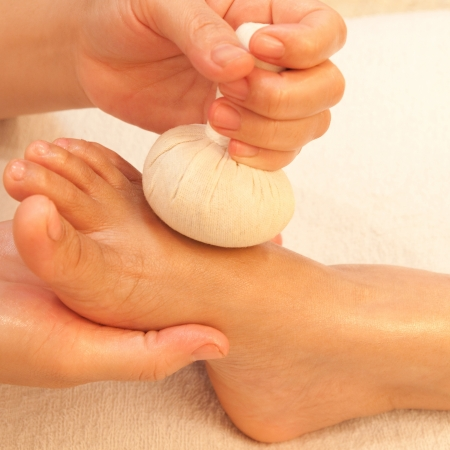 reflexology foot massage, spa foot treatment by ball herb,Thailand photo