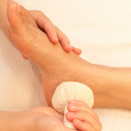 reflexology foot massage, spa foot treatment by ball herb,Thailand Stock Photo - 17949126