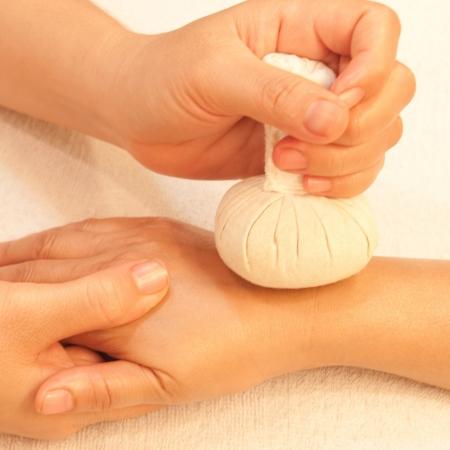 reflexology Hand massage by ball herbal, spa hand treatment,Thailand Stock Photo - 17949107