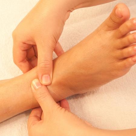 reflexology foot massage, spa foot treatment,Thailand Stock Photo - 17949129