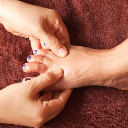 reflexology foot massage, spa foot treatment,Thailand Stock Photo - 17949155