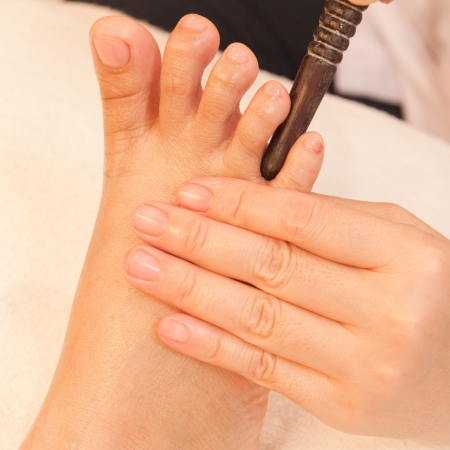 reflexology foot massage by stick wood, spa foot treatment,Thailand Stock Photo - 17949113