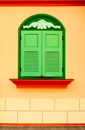 Colorful wall with green window  photo