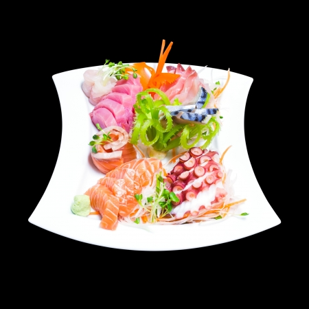 Mixed sashimi in white plate isolated on black background,with clipping path Stock Photo - 20411319