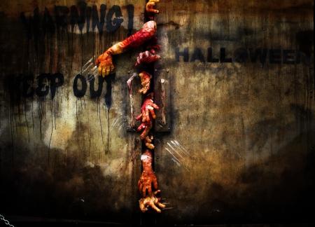 zombie hand: zombie hand through the door, useful for some Halloween concept  Stock Photo