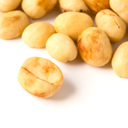 unroasted: unroasted coffee beans on white background