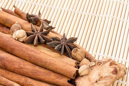 cannelle: Various spices on bamboo stick tied with a rope background