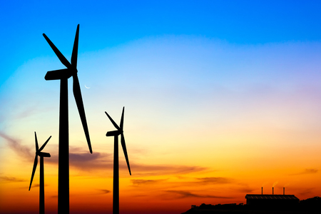 carbon neutral: Carbon credits concept,silhouette wind turbine generator with factory emissions of carbon dioxide on sunset background