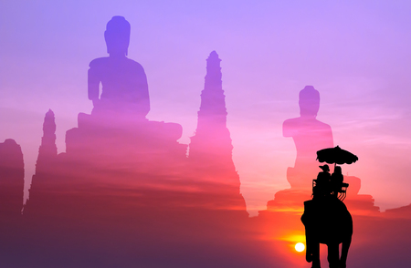 mahout: silhouette elephant with tourist with big buddha background at sunset,visit to Thailand concept