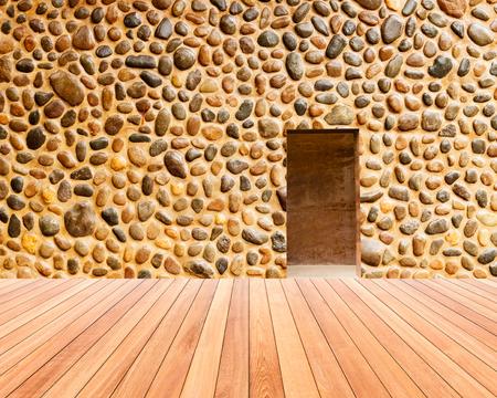 on wood floor: stone wall with door and wood floor Stock Photo